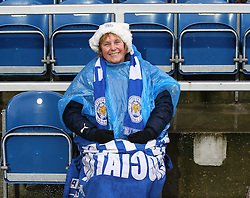 A Leicester City fan wrapped up against the rain at Loftus Road - Photo mandatory by-line: Robin White/JMP - Tel: Mobile: 07966 386802 21/12/2013 - SPORT - FOOTBALL - Loftus Road - London - Queens Park Rangers v Leicester City - Sky Bet Championship