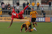 Newport County defender Matt Partridge upends York City forward Vadaine Oliver during the Sky Bet League 2 match between Newport County and York City at Rodney Parade, Newport, Wales on 5 September 2015. Photo by Simon Davies.