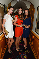 Left to right, sisters AMY PERFECT, ELLE CARING and LUCY PERFECT at an exhibition of the 50 best party pictures from Tatler from the past 50 years, held at Annabel's, Berkeley Square, London on 9th September 2013.