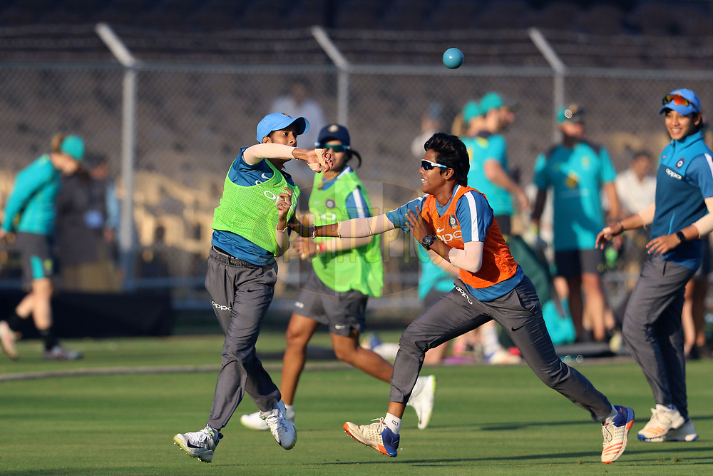 Indian players play throw ball before the start of the first women's one day International ( ODI ) match between India and Australia held at the Reliance Cricket Stadium in Vadodara, India on the 12th March 2018<br /> <br /> Photo by Vipin Pawar / BCCI / SPORTZPICS