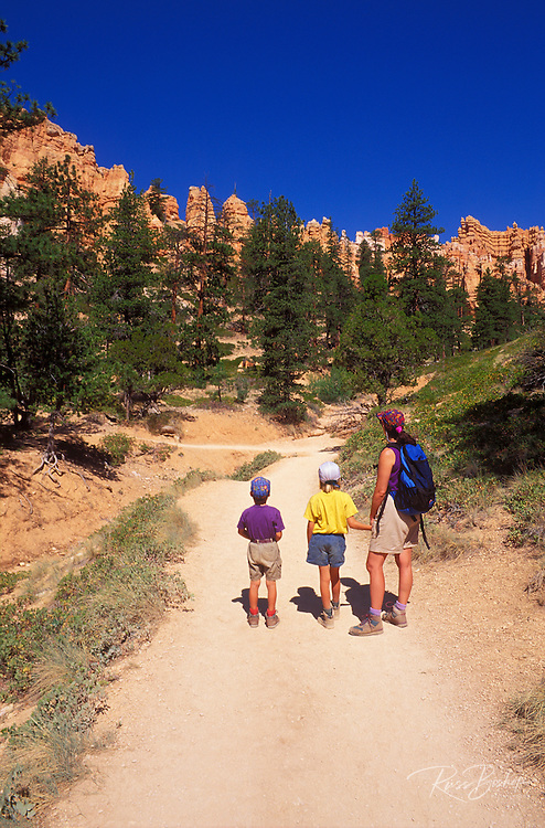 Mother and kids (age 4 & 8) hiking on the Navajo Trail in the Bryce Amphitheater, Bryce Canyon National Park, Utah