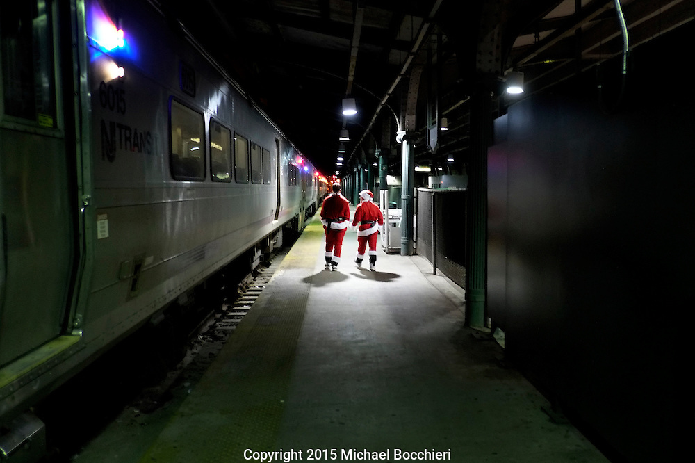 HOBOKEN, NJ - December 19:  People dressed as Santa Claus wait for a train in Hoboken Terminal on December 19, 2015 in HOBOKEN, NJ.  (Photo by Michael Bocchieri/Bocchieri Archive)