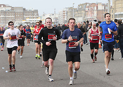 Runners make their way along Hove seafront during the Brighton Marathon, Sunday 14th April 2013 Photo by: Stephen Lock / i-Images