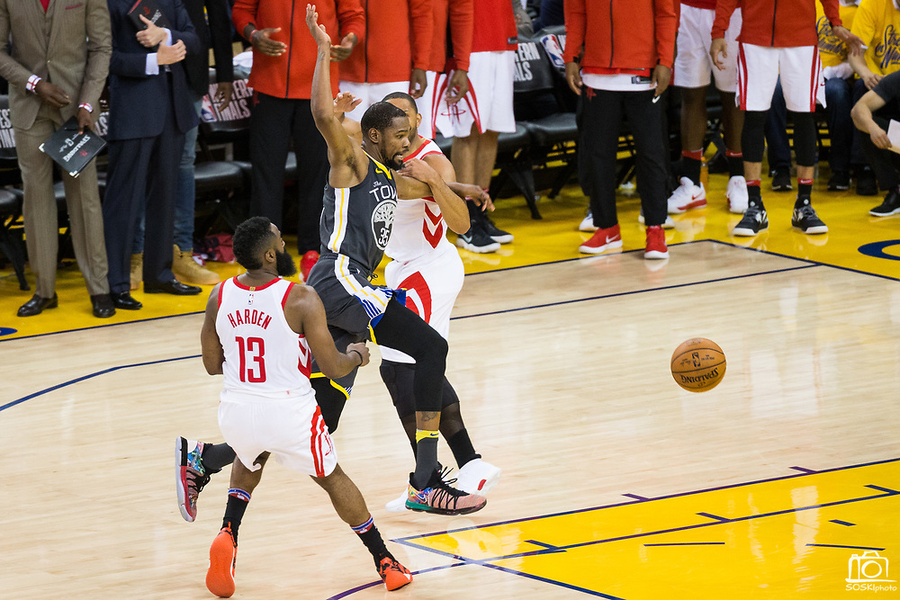 Golden State Warriors forward Kevin Durant (35) is fouled by the Houston Rockets during a fast break during Game 4 of the Western Conference Finals at Oracle Arena in Oakland, Calif., on May 22, 2018. (Stan Olszewski/Special to S.F. Examiner)