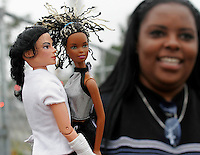 A Michael Jackson fan holds up a Jackson doll at the court in Santa Maria, California where his trial is taking place June 2, 2005. Closing arguments began in the Jackson sex abuse trial, the final showdown between prosecutors and defense lawyers in a bitter, four-month court fight that could end in prison for one of the world's best-known entertainers.