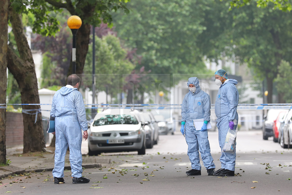 © Licensed to London News Pictures. 31/05/2018. London, UK. Forensics officers Finborough Road near Cathcart Road, Kensington, where a man believed to be in his 40s was found with multiple stab wounds. The man died at the scene and a murder investigation has been launched. Photo credit: Rob Pinney/LNP