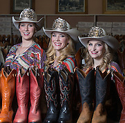 Stampede Princess, Stephanie Patterson, left, Stampede Queen, Danica Heath, centre, and Stampede Princess, Shannon Black, right, pose at the Alberta Boot Company in Calgary on Monday May 26, 2014. (Jenn Pierce/Calgary Herald)