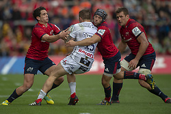 October 20, 2018 - Limerick, Ireland - Jason Woodward of Gloucester tackled by Joey Carbery and Duncan Williams of Munster during the Heineken Champions Cup match between Munster Rugby and Gloucester Rugby at Thomond Park in Limerick, Ireland on October 20, 2018  (Credit Image: © Andrew Surma/NurPhoto via ZUMA Press)