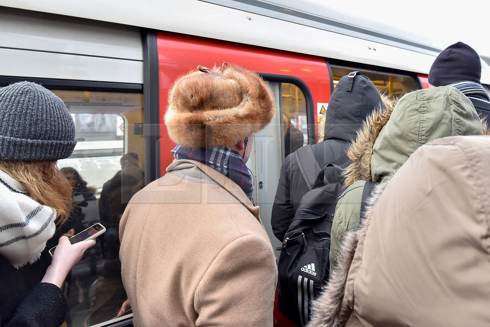 "© Licensed to London News Pictures. 26/02/2018. LONDON, UK. Morning commuters are forced to crowd onto the platforms at Harrow on the Hill station in north west London during rush hour as they face long delays and cancelled tube trains due to a signal failure caused.  Their journey is made more difficult with snow flurries and freezing temperatures brought about by ""The Beast From The East"" arctic weather which has arrived in the UK.  Photo credit: Stephen Chung/LNP"