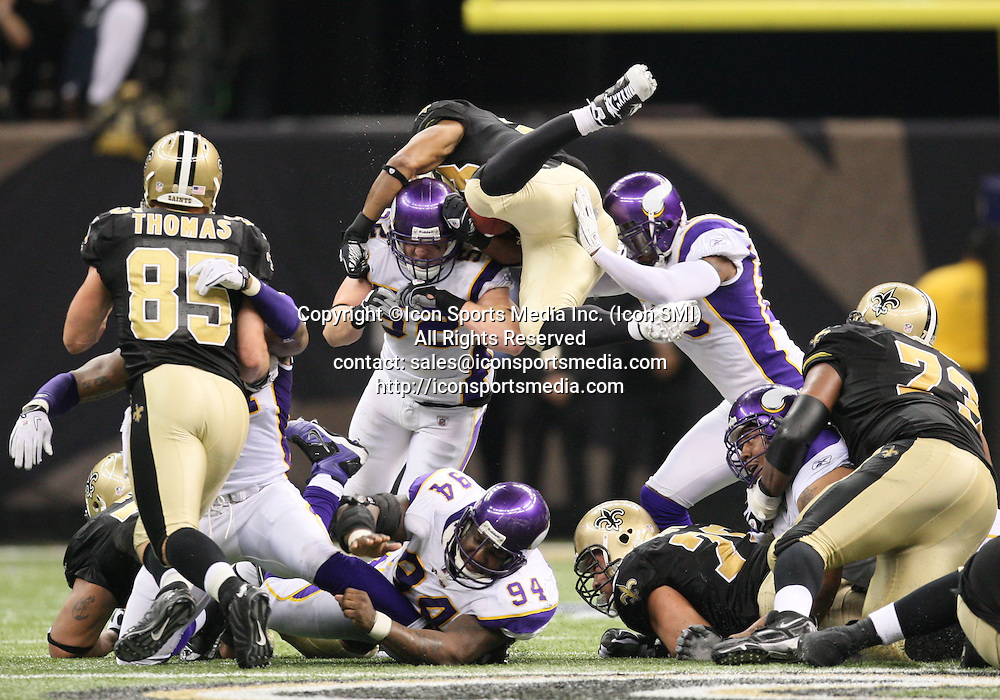 24 January 2010: New Orleans Saints running back Pierre Thomas (23) goes airborne in an attempt for a short yardage first down.  The New Orleans Saints defeated the Minnesota Vikings by a score of 31 to 28 at the Louisiana Superdome, New Orleans, LA.
