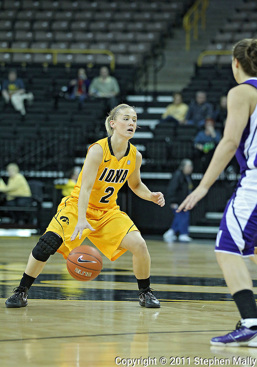 December 30, 2011: Iowa Hawkeyes guard Kamille Wahlin (2) brings the ball down court during the NCAA women's basketball game between the Northwestern Wildcats and the Iowa Hawkeyes at Carver-Hawkeye Arena in Iowa City, Iowa on Wednesday, December 30, 2011.