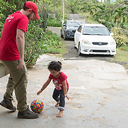 NOVEMBER 17, 2017&ndash;MARICAO, PUERTO RICO&mdash;<br /> Mercy Corps's Scott Latta plays around with Kayla Ferrer Colon, 2. Kayla's mom received a cash amount and water filtration system from Mercy Corps in the town of Maricao.<br /> (Photo by Angel Valentin)