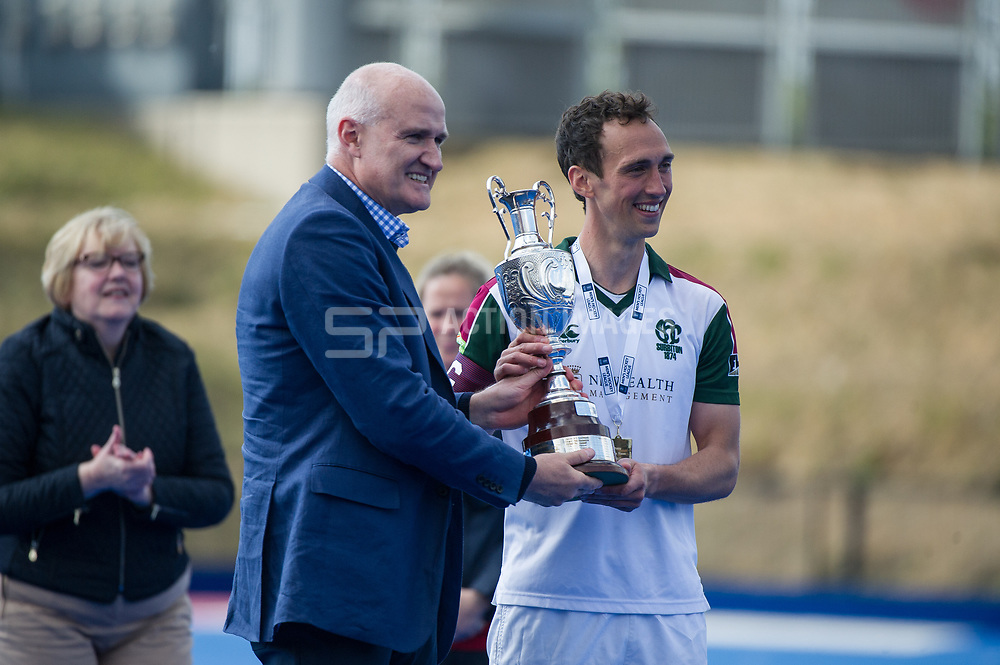 Surbiton captain, Lewis Prosser, receives the trophy. Wimbledon v Surbiton - Men's Hockey League Final, Lee Valley Hockey & Tennis Centre, London, UK on 23 April 2017. Photo: Simon Parker