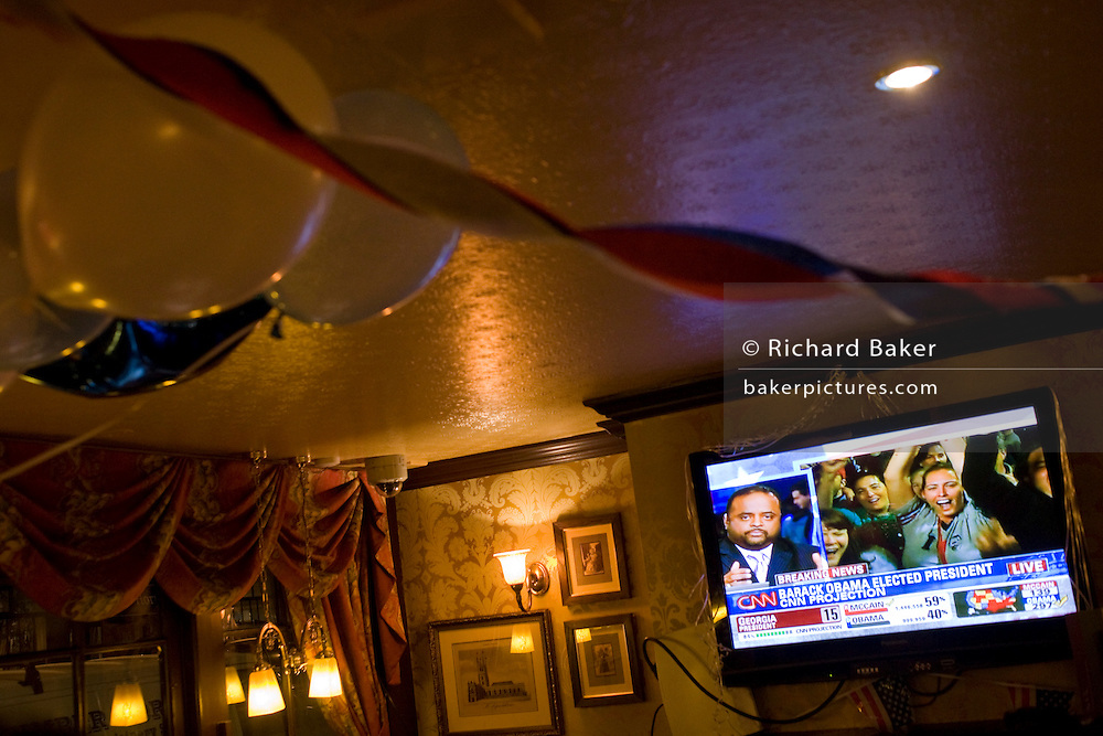 TV screen announces Barack Obama is declared Presidential election winner by CNN during overnight election party in London