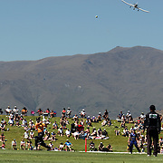 Grant Elliot, Wellington, hits a six as a light aircraft prepares to land at Queentown airport during the Otago Voltz V Wellington Firebirds HRV Cup match at the Queenstown Events Centre, Queenstown, New Zealand. 31st December 2011