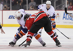 Mar 8; Newark, NJ, USA; New York Islanders center Frans Nielsen (51) and New Jersey Devils center Adam Henrique (14) face off during the first period at the Prudential Center.