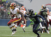 Nov 5, 2017; Seattle, WA, USA; Washington Redskins tight end Vernon Davis (85) is tackled by Seattle Seahawks defensive back Bradley McDougald (30) during an NFL football game at CenturyLink Field.