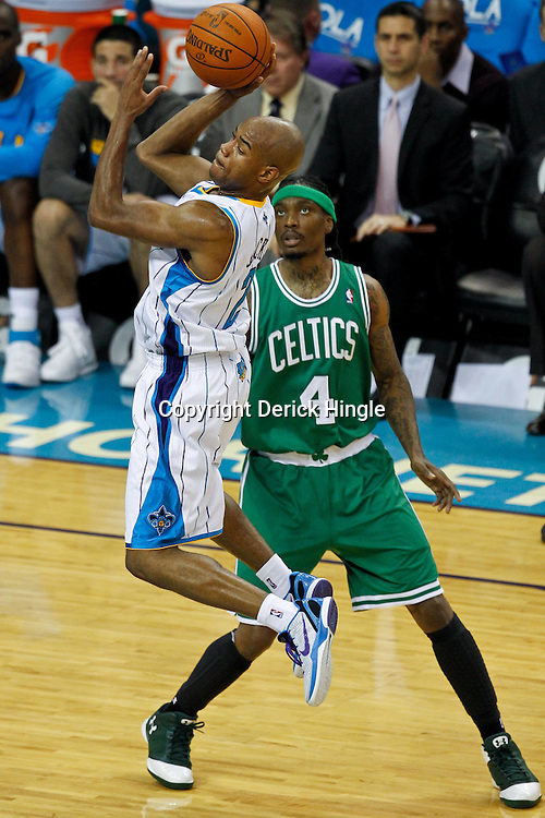 December 28, 2011; New Orleans, LA, USA; New Orleans Hornets point guard Jarrett Jack (2) shoots as Boston Celtics guard Marquis Daniels (4) defends during the second quarter of a game at the New Orleans Arena. The Hornets defeated the Celtics 97-78.   Mandatory Credit: Derick E. Hingle-US PRESSWIRE