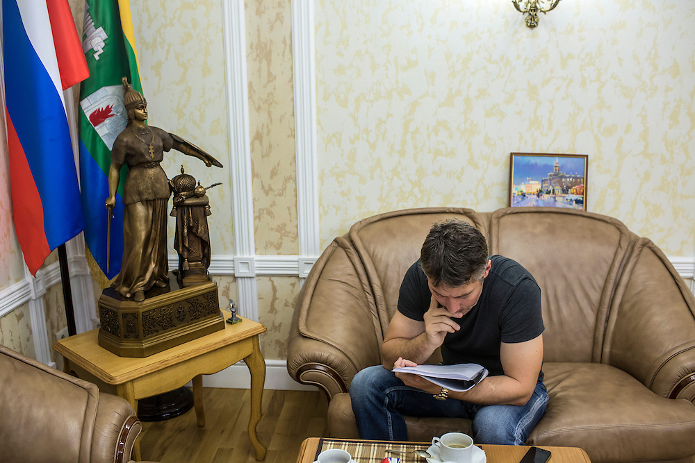 YEKATERINBURG, RUSSIA - OCTOBER 17: Yekaterinburg Mayor Yevgeny Roizman reads a briefing book in his office on October 17, 2013 in Yekaterinburg, Russia. Roizman was elected mayor of Yekaterinburg, Russia's fourth-largest city, in a surprise victory in September based on a platform of anti-corruption and his local notariety for founding a popular anti-drug addiction program called City Without Drugs. Widely seen as politically opposed to Vladimir Putin, Roizman is the highest placed opposition figure in public office in Russia. (Photo by Brendan Hoffman/Getty Images) *** Local Caption *** Yevgeny Roizman