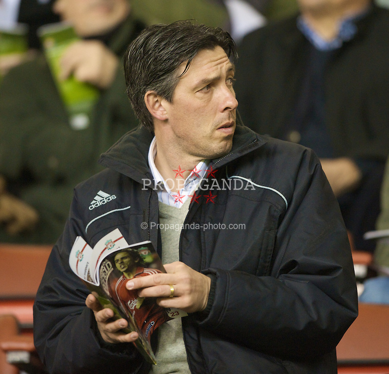 LIVERPOOL, ENGLAND - Wednesday, March 5, 2008: Liverpool's reserve team manager Gary Ablett reads the match-day programme during the Premiership match at Anfield. (Photo by David Rawcliffe/Propaganda)