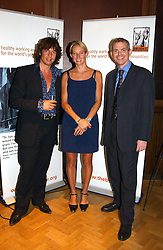 Left to right, LAURENCE LLEWELLYN-BOWEN, he is the interior designer, TV vet EMMA MILNE and MIKE BAKER Chief Executive of the Brooke Hospital for Animals at a reception in aid of Brooke Hospital for Animals held at Montes, Sloane Street, London SW1 on 22nd June 2004.