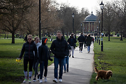 © Licensed to London News Pictures. 21/03/2020. LONDON, UK. People enjoy the sun on Clapham Common, London, on 21 March 2020. The government has recently asked people to practice social distancing in order to stop the spread of the Coronavirus. Photo credit: Luke Dray/LNP