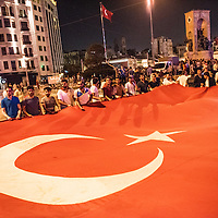 AKP suporter/protesters waving flag at Taksim square