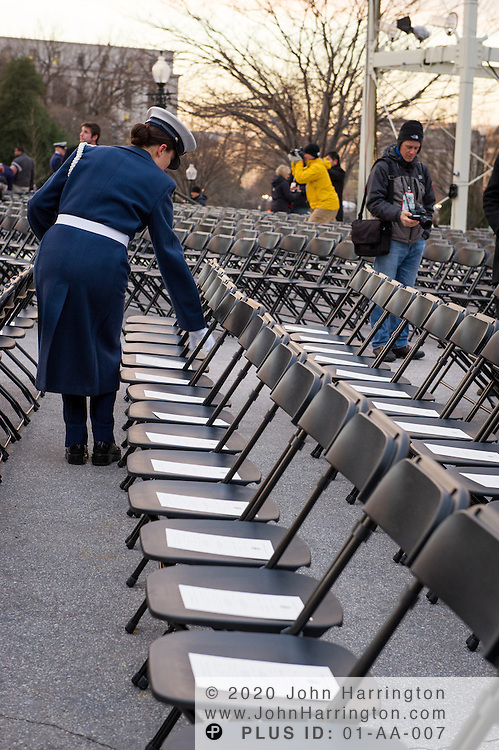 Coast Guard placing programs on the seats for the 57th Presidential Inauguration of President Barack Obama at the U.S. Capitol Building in Washington, DC January 21, 2013.