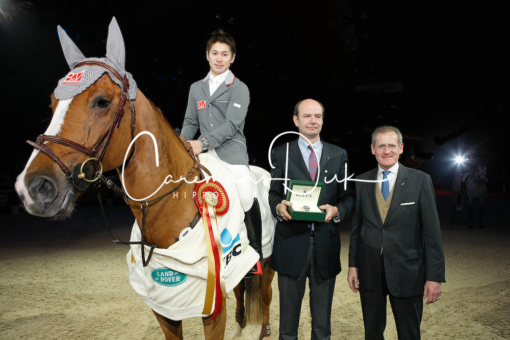 Sato Eiken (JPN) - Cartoon Z receiving the Rolex watch from Mr.     and Mr John Roche<br /> Winner Rolex Fei World Cup Qualifier<br /> CSI-W Mechelen 2009<br /> Photo © Dirk Caremans