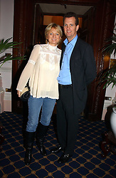 TV presenter ALICE BEER and MR PAUL PASCOE at a reception to launch Angel themed Christmas Cards and view an exhibition of the original art work by Gordon King with proceeds going to the Caron Keating Foundation  held at the Langham Hotel, Portland Place, London on 20th November 2006.<br />