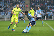 Coventry City midfielder Ruben Lameiras chips the ball gaolbird with Southend United defender John White looking on during the Sky Bet League 1 match between Coventry City and Southend United at the Ricoh Arena, Coventry, England on 31 August 2015. Photo by Simon Davies.