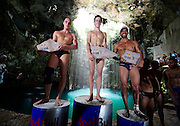 Sinkhole cliff diving competition held in Mexico<br /> <br /> Daredevil athletes have jumped from the edge of a 90ft deep sinkhole in a remote part of Mexico, as part of a cliff diving contest.<br /> Divers in the 'Cliff Diving World Series' performed stunts and reached speeds of 40mph before hitting the dark water of Cenote Ik Kil.<br /> Gary Hunt, from Southampton was the overall winner and managed to pull off a Triple Quad – one of the most difficult dives in the world.<br /> The Red Bull event lasted for two days -- though most of that time was probably taken up trying to get back out after each jump. <br /> Gary scored 373.85 and edged out second-placed Silchenko by a little over 10 points, with 2009 champion Duque taking third place.<br /> <br /> Photo Shows: f.l.t.r Artem Silchenko (RUS), Gary Hunt (GBR), Orlando Duque(COL), during the prize giving ceremony for round two of the 2010 Red Bull Cliff Diving World Series. Gary Hunt finished 1st place with Artem Silchenko 2nd and Orlando Duque 3rd.  Cenote Ik Kil, Yucatan, Mexico on June 05; 2010.<br /> (©Ray Demski/Exclusivepix)