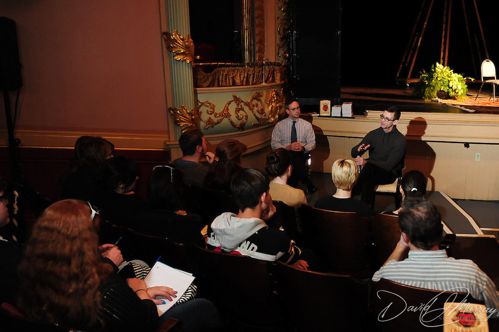 Author Chuck Palahniuk (R) and Todd Doughty of Doubleday meet with Portsmouth-area high school writing students and teachers before Chuck appears at The Music Hall in Portsmouth, NH. Nov. 3, 2011