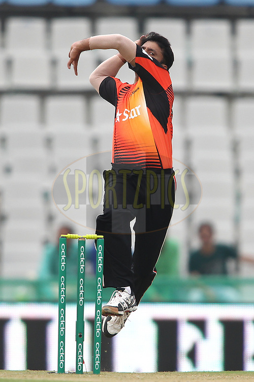 Yasir Arafat of the Perth Scorchers sends down a delivery during match 4 of the Oppo Champions League Twenty20 between the Dolphins and the Perth Scorchers held at the Punjab Cricket Association Stadium, Mohali, India on the 20th September 2014<br /> <br /> Photo by:  Shaun Roy / Sportzpics/ CLT20<br /> <br /> <br /> Image use is subject to the terms and conditions as laid out by the BCCI/ CLT20.  The terms and conditions can be downloaded here:<br /> <br /> http://sportzpics.photoshelter.com/gallery/CLT20-Image-Terms-and-Conditions-2014/G0000IfNJn535VPU/C0000QhhKadWcjYs