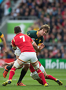 Twickenham, Great Britain, RSA's Lodewyk DE JAGER, tackled by &. Sam WARBURTON and Gareth ANSCOMBE, during the Quarter Final 1 game, South Africa vs Wales.  2015 Rugby World Cup,  Venue, Twickenham Stadium, Surrey, ENGLAND.  Saturday  17/10/2015.   [Mandatory Credit; Peter Spurrier/Intersport-images]