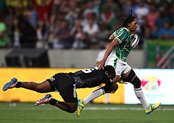 Tomasi Cama of New Zealand attempts to tackle Justin Geduld of South Africa during the Cup Final match between South Africa and New Zealand on Day 2 of the HSBC Sevens World Series Port Elizabeth Leg held at the Nelson Mandela Bay Stadium on 8th December 2013 in Port Elizabeth, South Africa. Photo by Shaun Roy/Sportzpics