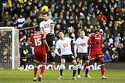 Derby County midfielder Bradley Johnson clears the ball with his head during the Sky Bet Championship match between Derby County and Cardiff City at the iPro Stadium, Derby, England on 21 November 2015. Photo by Aaron Lupton.