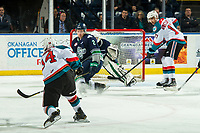 KELOWNA, CANADA - JANUARY 30: Trevor Wong #14 of the Kelowna Rockets takes a shot during first period as Simon Kubicek #2 of the Seattle Thunderbirds tries to block  on January 30, 2019 at Prospera Place in Kelowna, British Columbia, Canada.  (Photo by Marissa Baecker/Shoot the Breeze)