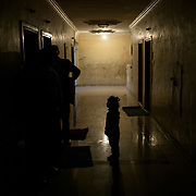 Syiran refugees stand in the corridors of their building, on december 22nd 2013 in Irbid.