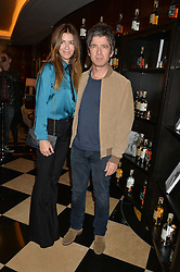 NOEL GALLAGHER and SARAH MacDONALD at the London launch of Casamigos Tequila hosted by Rande Gerber, George Clooney & Michael Meldman and to celebrate Cindy Crawford's new book 'Becoming' held at The Beaumont Hotel, Brown Hart Gardens, 8 Balderton Street, London on 1st October 2015.
