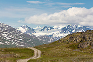 Off road vehicle trail at Thompson Pass in Southcentral Alaska. Summer. Afternoon.