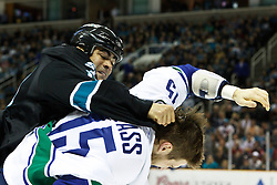 January 3, 2011; San Jose, CA, USA;  San Jose Sharks center Jamal Mayers (left) punches Vancouver Canucks center Tanner Glass (15) during the first period at HP Pavilion. Mandatory Credit: Jason O. Watson / US PRESSWIRE