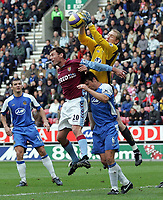 Photo: Paul Thomas.<br /> Wigan Athletic v Aston Villa. The Barclays Premiership. 19/11/2006.<br /> <br /> Wigan keeper Chris Kirkland (Yellow) wins the ball ahead of team mate Arjen De Zeeuw (6) and Villa's Chris Sutton (20).