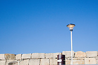 Street light running during the daytime on Dun Laoghaire Pier in Dublin Ireland.