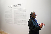 "55th Art Biennale in Venice - The Encyclopedic Palace (Il Palazzo Enciclopedico).<br /> Arsenale.<br /> U.A.E. exhibition.<br /> Mohammed Kazem (Dubai) being interviewed about his ""Walking on Water - Directions"", 2005/2013."