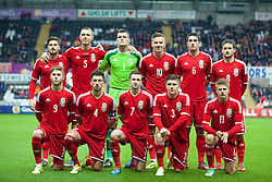 SWANSEA, WALES - Monday, May 19, 2014: Wales' players line up for a team group photograph before the 2015 UEFA European Under-21 Championship Qualifying Group 1 match against England at the Liberty Stadium. Back row L-R: Kieron Freeman, George Ray, goalkeeper Connor Roberts, Lee Evans, Joe Walsh, Josh Pritchard. Front row L-R: Wes Burns, captain Lee Lucas, Gwion Edwards, Declan John, Lloyd Isgrove. (Pic by David Rawcliffe/Propaganda)