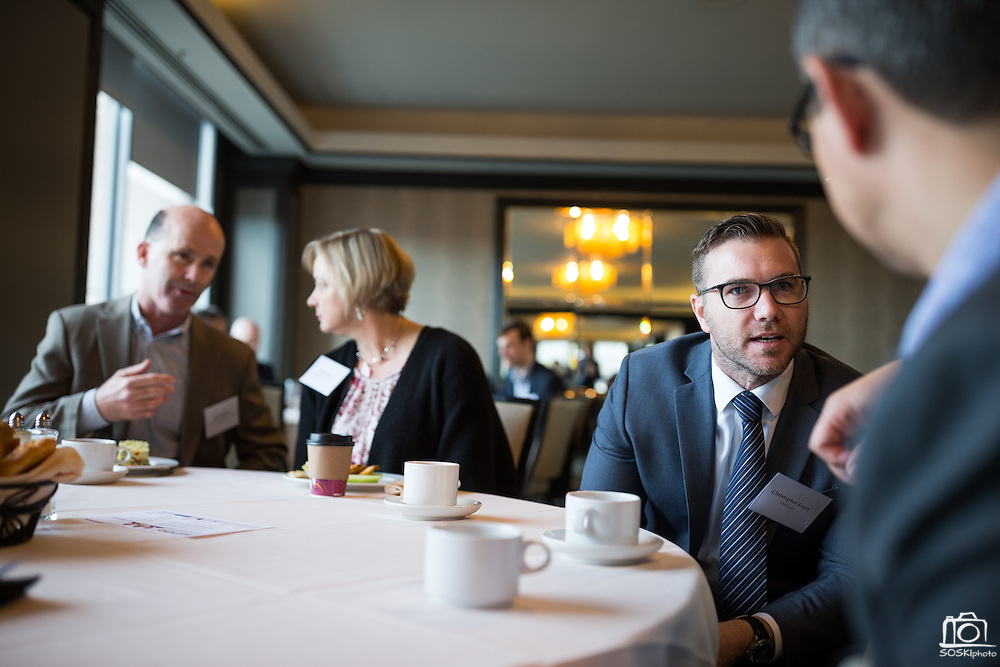 Christopher Every talks with other attendees before the Silicon Valley Business Journal Power of Manufacturing Breakfast at the Silicon Valley Capital Club in San Jose, California, on January 24, 2017. (Stan Olszewski for Silicon Valley Business Journal)