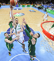 Mirza Begic of Slovenia vs Darius Songaila of Lithuania and Robertas Javtokas of Lithuania during basketball game between National basketball teams of Slovenia and Lithuania at of FIBA Europe Eurobasket Lithuania 2011, on September 15, 2011, in Arena Zalgirio, Kaunas, Lithuania. Lithuania defeated Slovenia 80-77.  (Photo by Vid Ponikvar / Sportida)