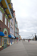 The Boardwalk is usually very busy in the summer compared to the winter in Atlantic City , New Jersey