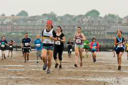 Runners gathered for the annual Portobello Beach Run this morning across the sands of Portobello Beach. Starting and finishing at the Promenade bar, The Dalriada, the runners went to the far end of the beach at Seafield and back again, splashing through the Figgate Burn twice on their way.<br /> &copy; Jon Davey/ EEm